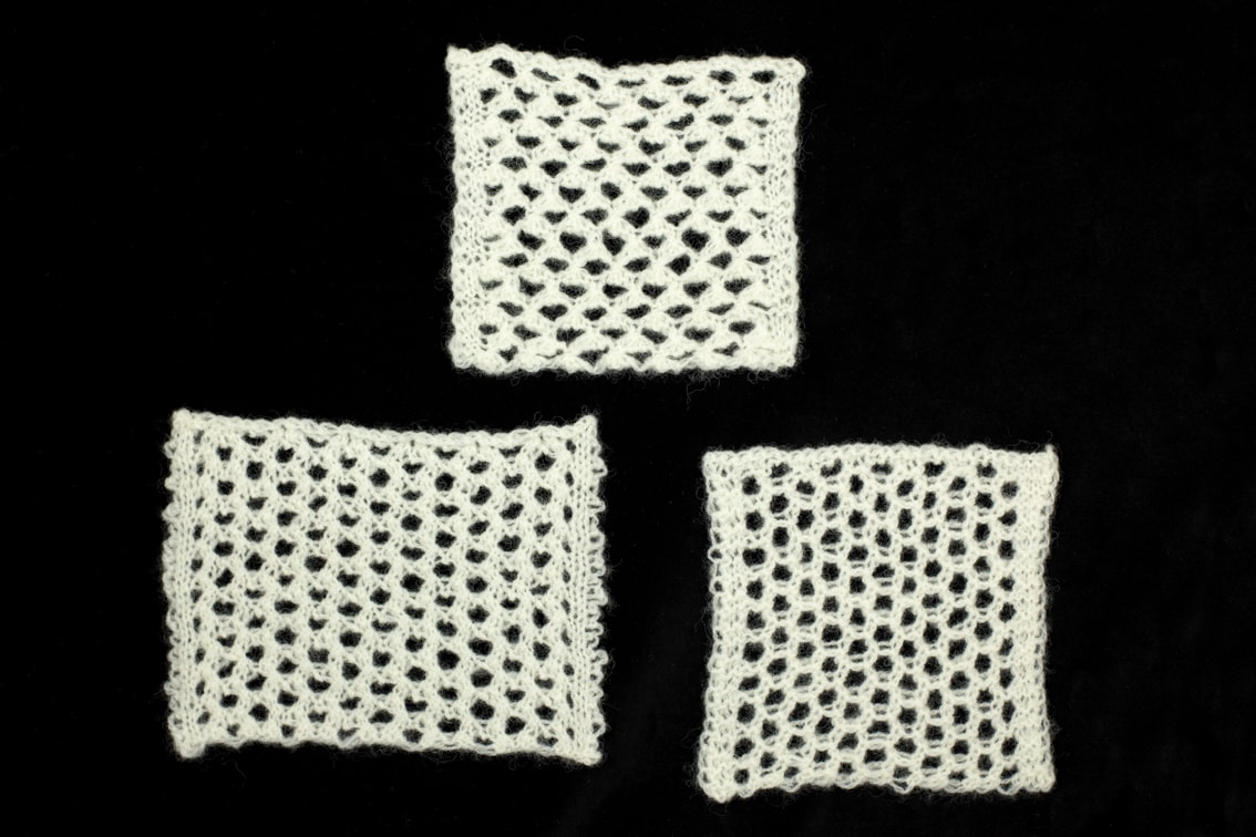 Openwork hand knitwear design swatches by Alice Starmore